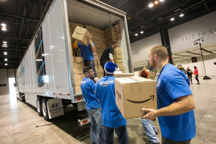 Amazon workers packing a tractor-trailer at one of its warehouses. PETER  WYNN THOMPSON